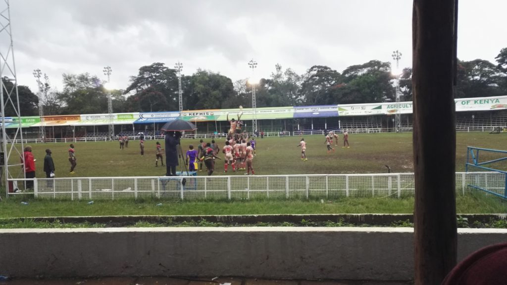 Watching a rainy rugby match in Nairobi